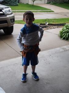 Cam wearing his new tool belt.